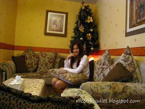 sitting at christmas tree
