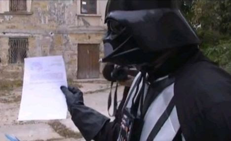 Mission accomplished: Darth Vader holds an old-fashioned piece of paperwork after registering for the scheme