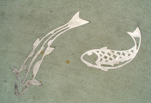 Trend South Fished Street of Bestor Park features bronze and stainless steel elements depicting fish embedded in the concrete sidewalk