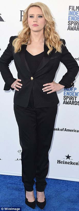 Slinky: (from left) Kristina Bazan wore a low-cut tank top with loose slacks and gold heels, Liev Schreiber wore a dapper suit with brown shoes and Kate McKinnon looked professional in a black suit