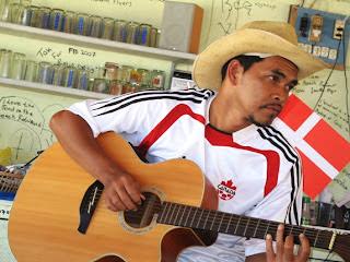 Guitar Man at the Beach Bar