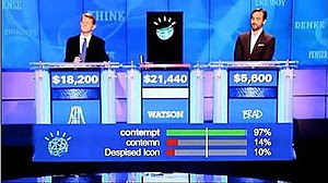 Watson, Ken Jennings, and Brad Rutter in their...
