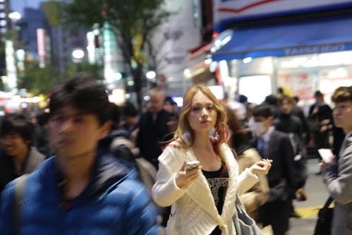 A woman lost amidst the Shibuya chaos