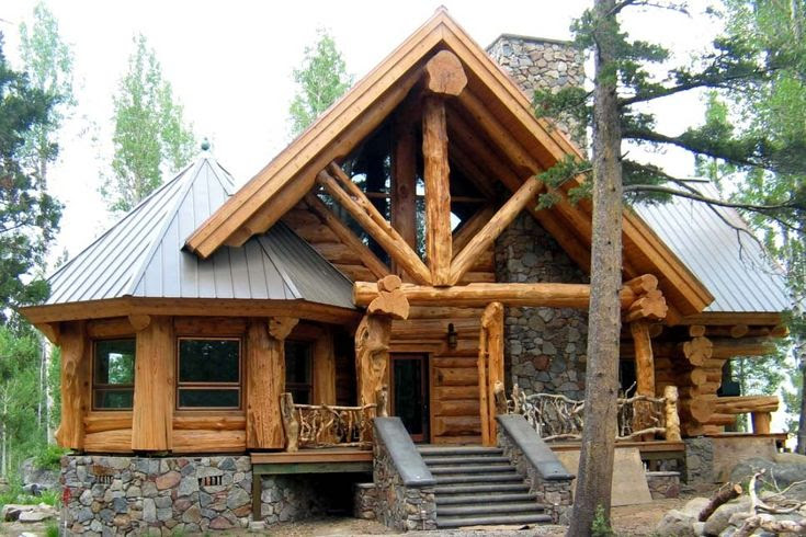 Cabin by the lake, love the massive beams and columns, and the angled left side.  Beautiful!