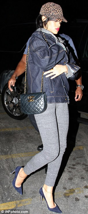 Keeping it causal: Rihanna wore an over-sized denim jacket with a grey fitted tracksuit and navy heels
