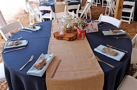 Burlap runners over navy tablecloths   Snowflake Wedding