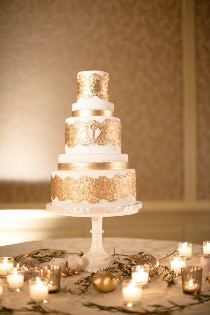 Wedding Cake with Gold Decor | See the wedding on Style Me Pretty:  http://www.stylemepretty.com/california-weddings/laguna-beach/2013/01/07/montage-laguna-beach-wedding-from-jana-williams-photography/  Jana Williams Photography