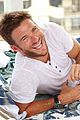 scott eastwood hangs by the pool at treats party 03