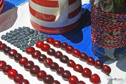 Order a sheet cake with white frosting from the bakery. Add blueberries for the stars and cherries for the stripes.
