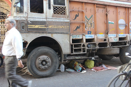 home is under the wheels of a truck by firoze shakir photographerno1