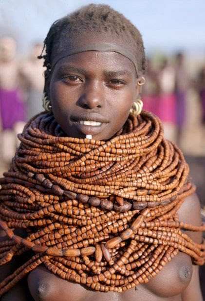 Africa | Nyangatom woman wearing numerous strands of beads made from wood.  Omo River, southwest Ethiopia | ©Nigel Pavitt / John Warburton-Lee
