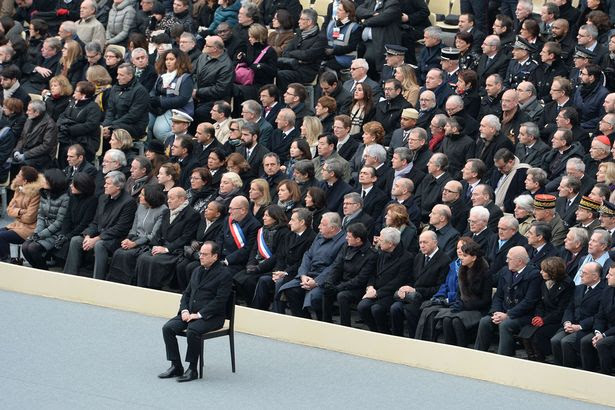 "French President Francois Hollande (C) attends with French members of governement (back) the ""national and republican"" tribute"