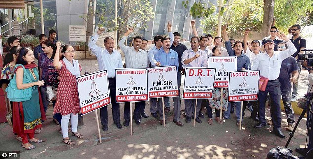 Kingfisher employees protest against liquor baron Vijay Mallya for non-payment of dues outside Kingfisher's office in Ville Parle in Mumbai