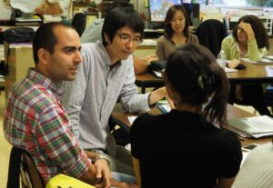 Hessam Ghajar, a recent immigrant from Iran, practices English with classmates in a San Mateo Adult School class.