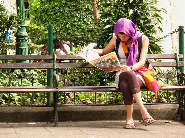 Tourist reading Nuestro Diario from Guatemala