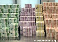 Large piles of euro banknotes