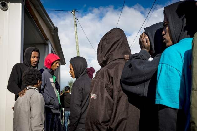 Unaccompanied children in the Calais migrant camp await interviews with the UK Home Office, October 22, 2016. © 2016 Zalamai/Human Rights Watch