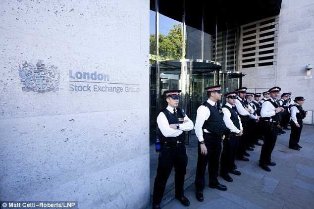 Protection: City of London Police guard an entrance to the London Stock Exchange during the Occupy London protest