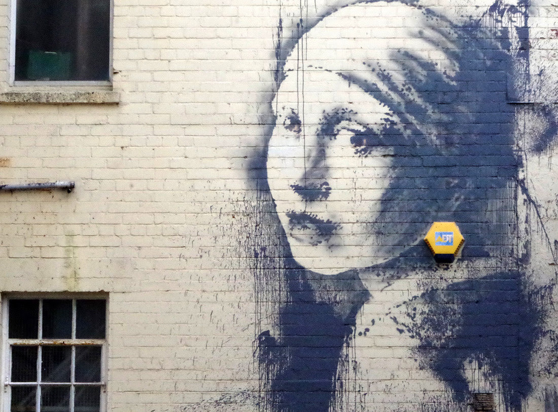 Girl with a Pierced Eardrum by Banksy street art murals