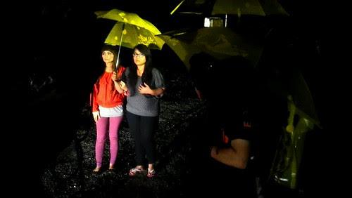 Lead actresses Wawa Zainal and Elliza Razak acting in the rain