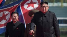 North Korean leader Kim Jong-Un (R) arrives flanked by vice-chairman of the State Affairs Commission Choe Yong-Hae (L) at an opening ceremony for 'Rymoyong street', a new housing development in Pyongyang, on April 13, 2017. With thousands of adoring North Koreans looking on -- along with invited international media -- Kim Jong-Un opened a prestige housing project as he seeks to burnish his nation's image even as concerns over its nuclear capabilities soar. / AFP PHOTO / ED JONES        (Photo credit should read ED JONES/AFP/Getty Images)