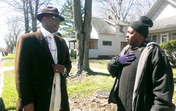 Benton Harbor Commissioner Marcus Muhammad, who is running for mayor against Hightower (l) talks with James Cornelius, who initiated recall campaign against Hightower. Final Call photo