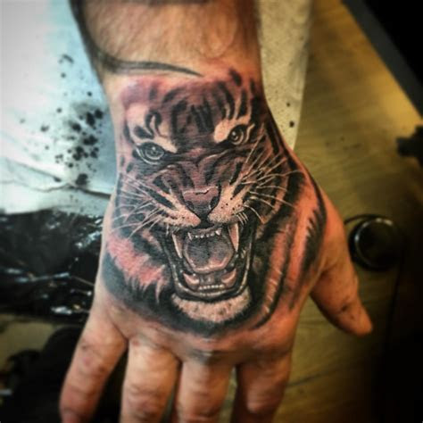 rampant ink twitter tiger hand tattoo saint