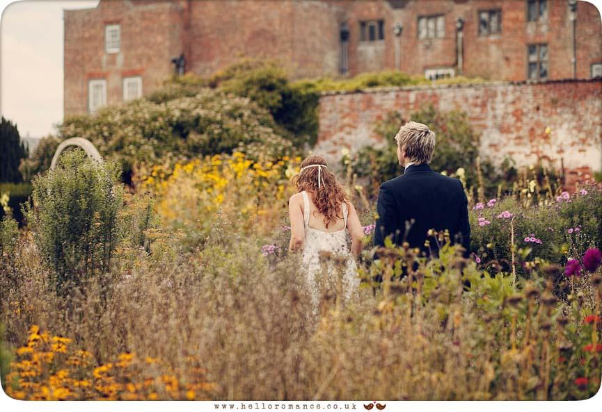 Bride and Groom Walking through Flowers, Glemham Hall Wedding Photography Suffolk - Hello Romance