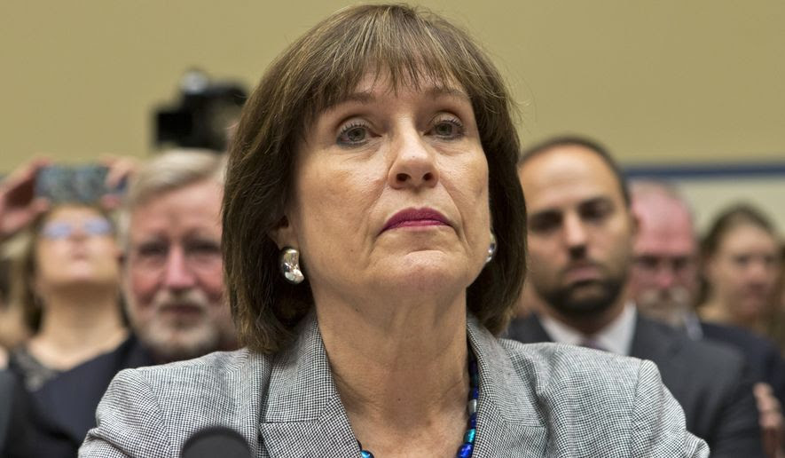 Lois Lerner listens during a hearing on the IRS's alleged targeting of tea party groups for additional scrutiny on Capitol Hill on May 22, 2013. (Associated Press)