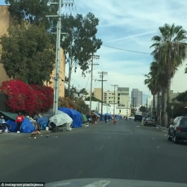 The video shows rubbish bags piled up by the pavements and littered across streets, and tents erected in clusters where people have camped down for the night