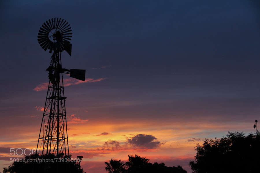 Photograph windmill and colorful sky by Miguel Angel Castillo on 500px