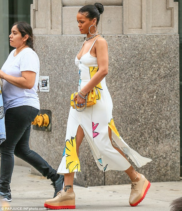 Showing some skin: The dress clung to Rihanna's curves and boasted several slits which showed off her legs