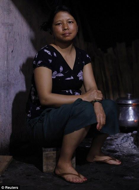 Matluangi, 37 anos, a 19ª esposa de Ziona