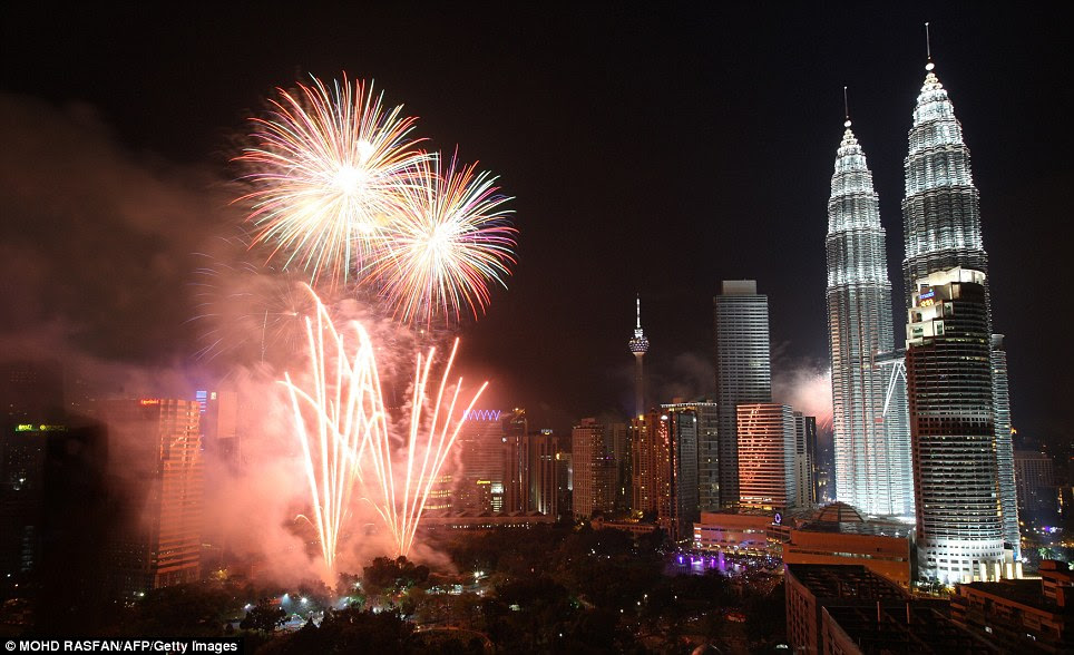MALAYSIA: Fireworks display near the country's landmark Petronas twin towers during the New Year celebrations as the clock strikes 12