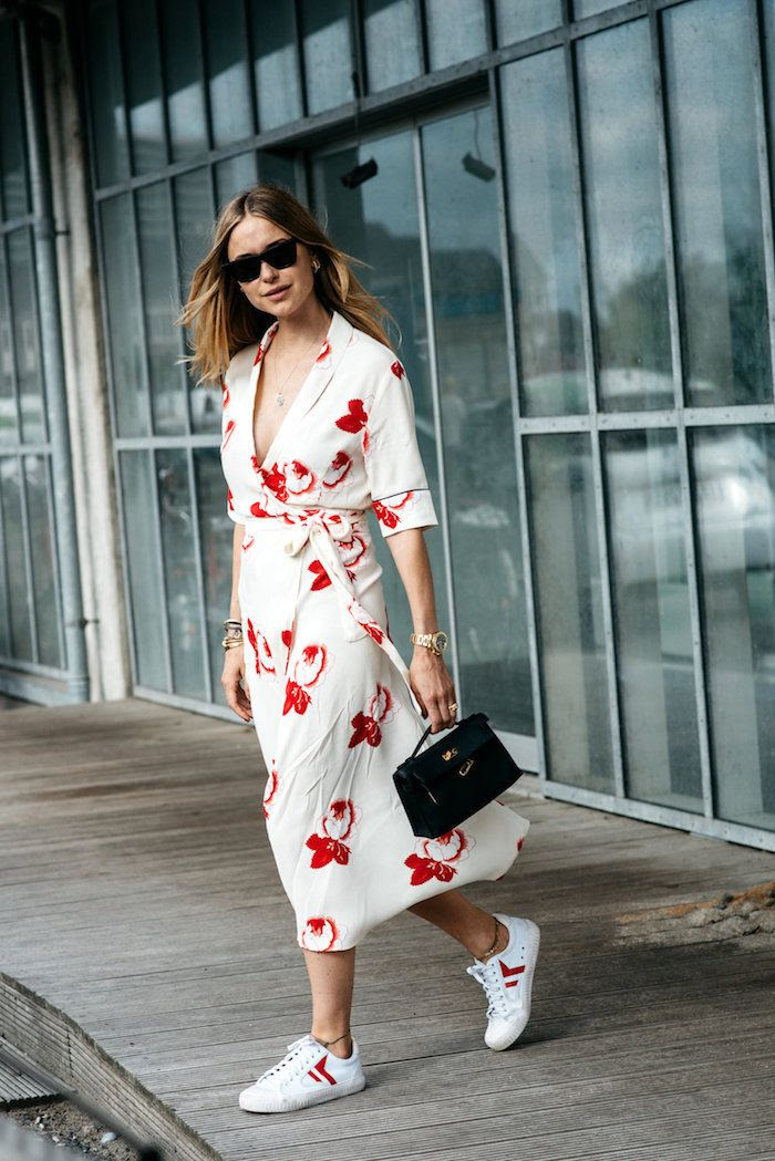 Pernille Teisbaek Street Style Ganni Print Midi Dress Celine Sneakers Black Bag Copenhagen Fashion Week Midi Dress Sneakers Trend Scandinavian Style Le Fashion Blog Via The Locals