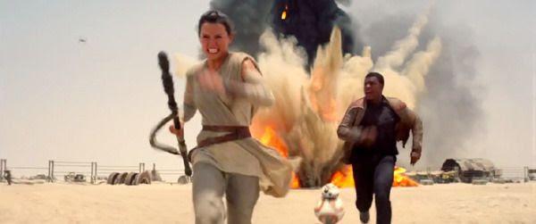 Rey (Daisy Ridley), Finn (John Boyega) and BB-8 flee from a marauding TIE Fighter (upper-left) in STAR WARS: THE FORCE AWAKENS.