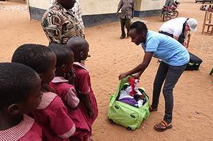Elisabeth giving gifts to children at Mboti School, Kenya