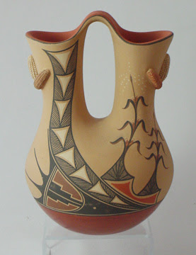 http://www.finepueblopottery.com/1588.4F.jpg