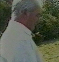 MISSING ABUSER No 1 This image of an unknown man watching other men having sex with the young girl was taken by Fred Lawlor. Photo: North Wales Police