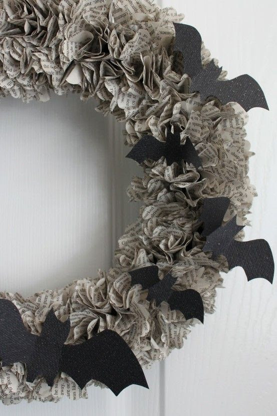 25 Halloween Wreaths-I am in love with that black and white print with the bats one...What is it about things made out of books that i love so much? Oh yeah, don't answer that...