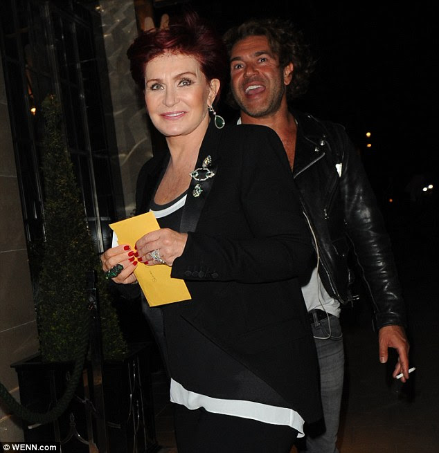 Returned: Sharon Osbourne returned to The Claridge's hotel holding a yellow card in her hand on Wednesday evening