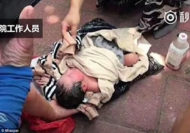A newborn girl was found in a parcel wrapped in plastic bags in southeast China's Fuzhou