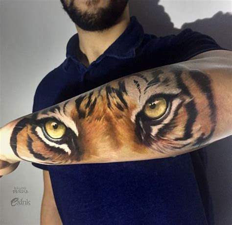 realistic tiger eyes tattoo  forearm  bruno perdiz