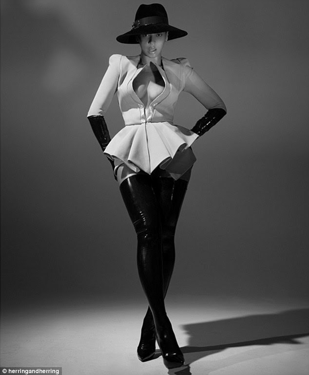 Thigh high stunner: Beyonce shows off her enviable curves in a pair of leather boots and a white peplum short and gloves in images taken from a Herring & Herring photoshoot, some of which were used for her 2014 calender