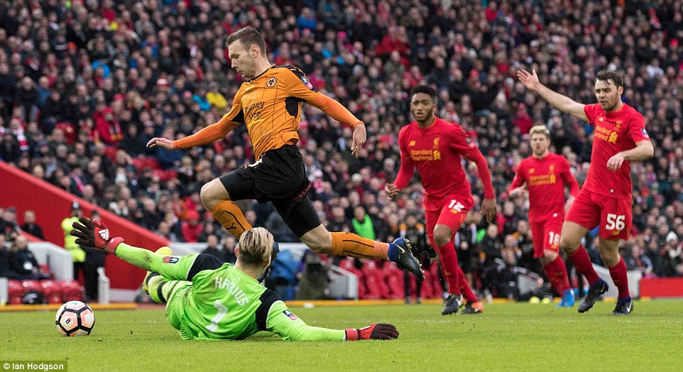 Andreas Weimann rounds Loris Karius after being put clean through on goal and slots into the empty net for Wolves
