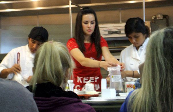 Whitney Miller conducts a cooking demo in Costa Mesa, California, on February 9, 2013.