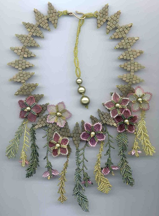 The Cinquefoils & Ferns necklace introduces five petaled flowers and feathery ferns that seem to sprout from between the stones of a garden path.  The student may choose to work with either size 11` or 15` seed beads for the flowers and ferns.  4mm cubes represent the garden path.