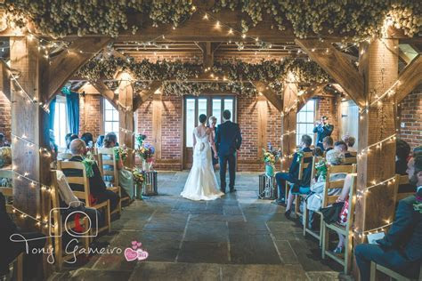 Ceremony in our high beam barn, decorated with colourful