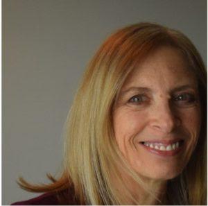 Leslie Hadley headshot against a gray background
