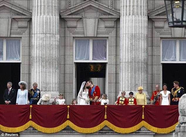 A very public kiss: William and Catherine share a special moment on the Buckingham Palace balcony as thousands watch on